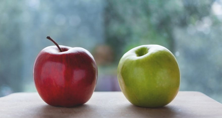 a red apple and a green apple representing the difference between income protection and critical illness cover