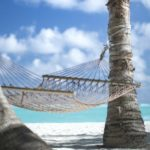 An image of a hammock on a beach signifying a mortgage holiday